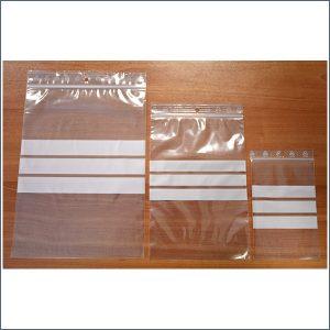 bolsas transparentes para comprar con autocierre y franjas blancas en el medio